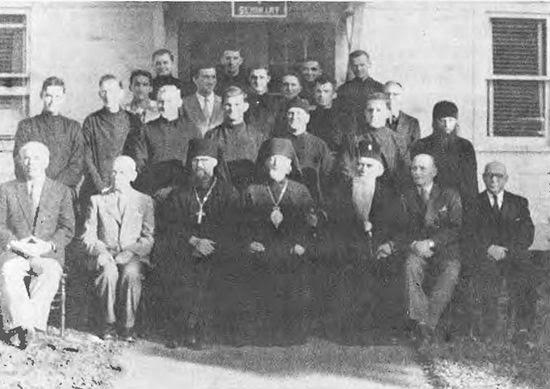 St. Nikolai, seated fifth from left, with faculty and students of St. Tikhon's Seminary.
